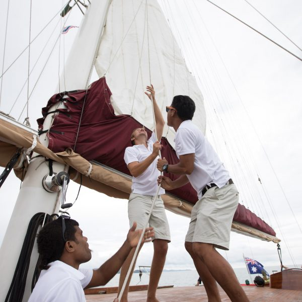 Sailors lifting the sails