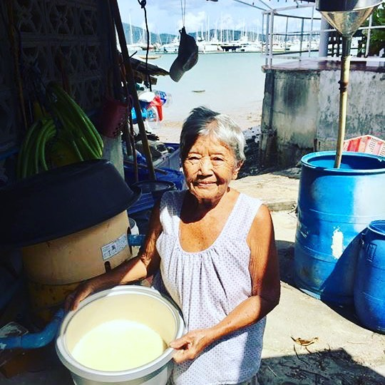 Mama showing us the fresh coconut milk