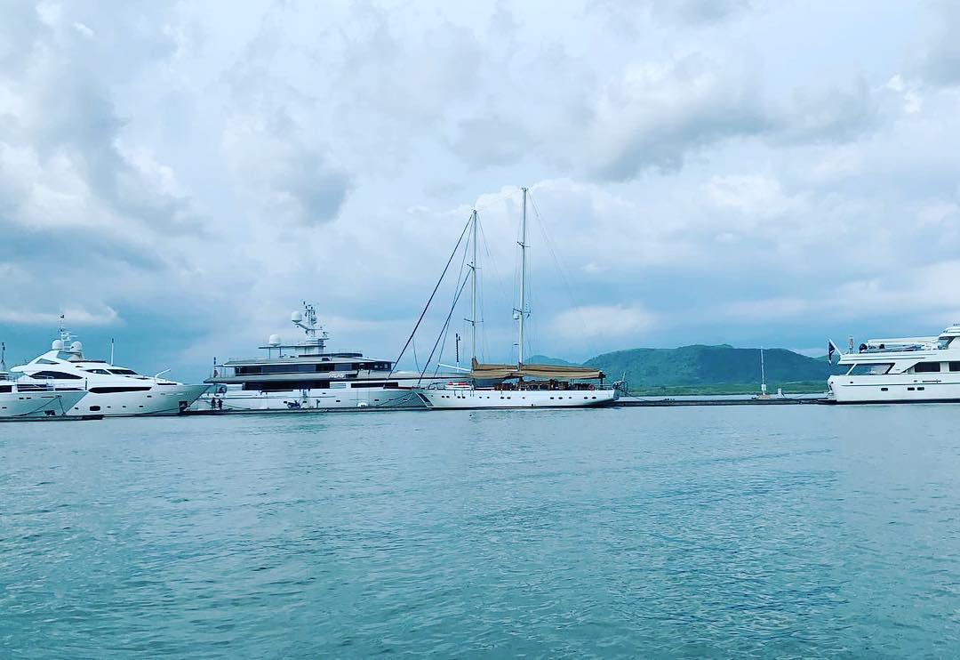 She looks good in between all those modern super yachts